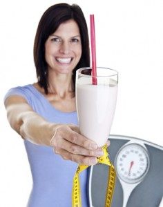 lady holding meal replacement shake